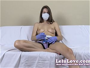 braless woman with medical mask and strap-on
