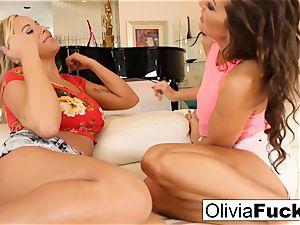 Olivia Austin and Abigail Mac poke