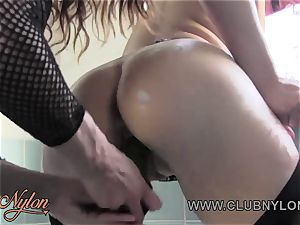 ginger-haired girly-girl in nylons masturbates toys in tub