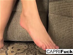 Capri plays with her labia and feet