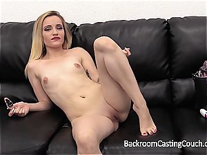 Alenia stretches her gams on the casting sofa