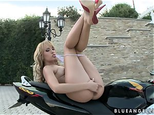 Blue Angel groping her pleasure button while on her motor bike