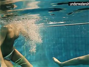 two sexy amateurs demonstrating their bodies off under water