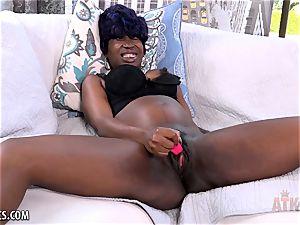 Tiana Grey plays with her dark-hued vagina