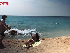 LETSDOEIT - warm ebony teen boinked stiff At The Beach