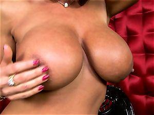 stellar Lisa Ann exposes her huge edible bra-stuffers